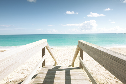 Wooden stairs put the beautiful beach at your doorstep.