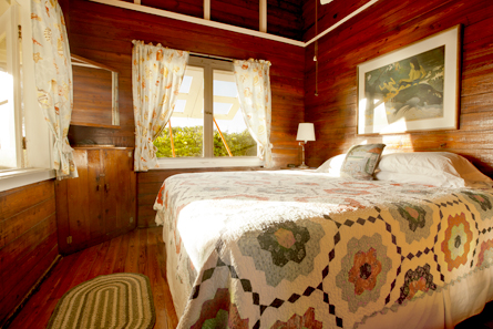 Front bedroom with king-size bed and view of the Atlantic Ocean.