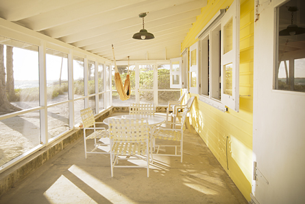 Spacious screen porch stretches the full front of Seagrape and features lighting, hammock, table and chairs.